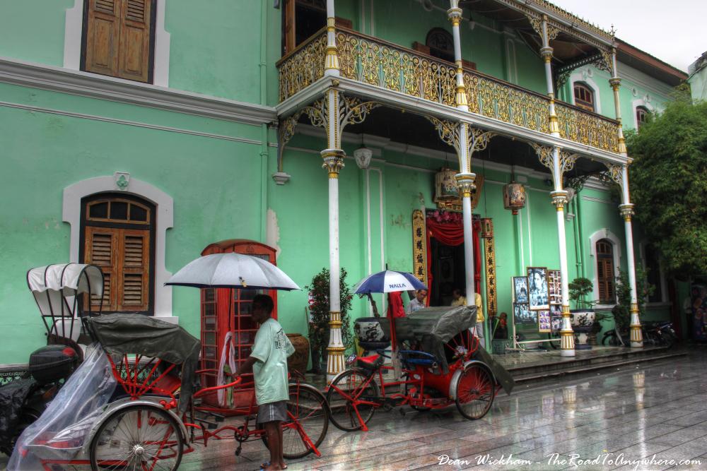 Trishaws outside Pinang Peranakan Mansion in George Town, Malaysia
