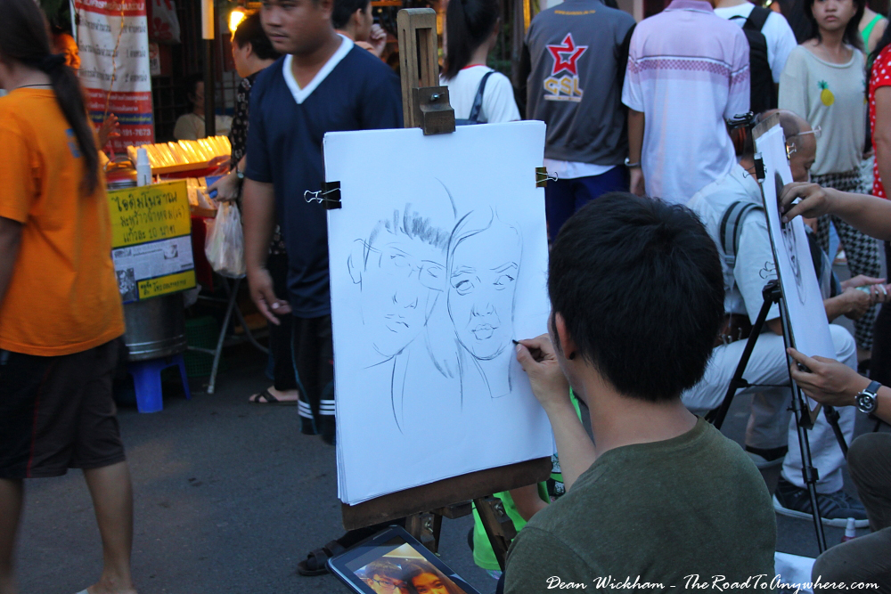 Portrait artist at the Sunday Market in Chiang Mai, Thailand