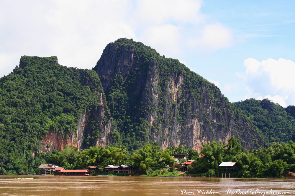 A village and karst mountain on the Mekong River, Laos