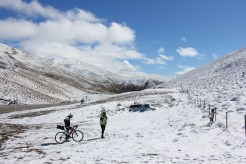 Cyclists in the snow on the Crown Range, New Zealand