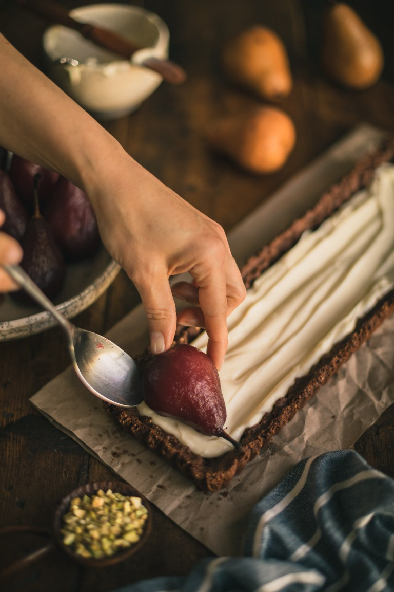 Poached Pears in a Chocolate, and Mascarpone Nutty Tart with Malbec Molasses
