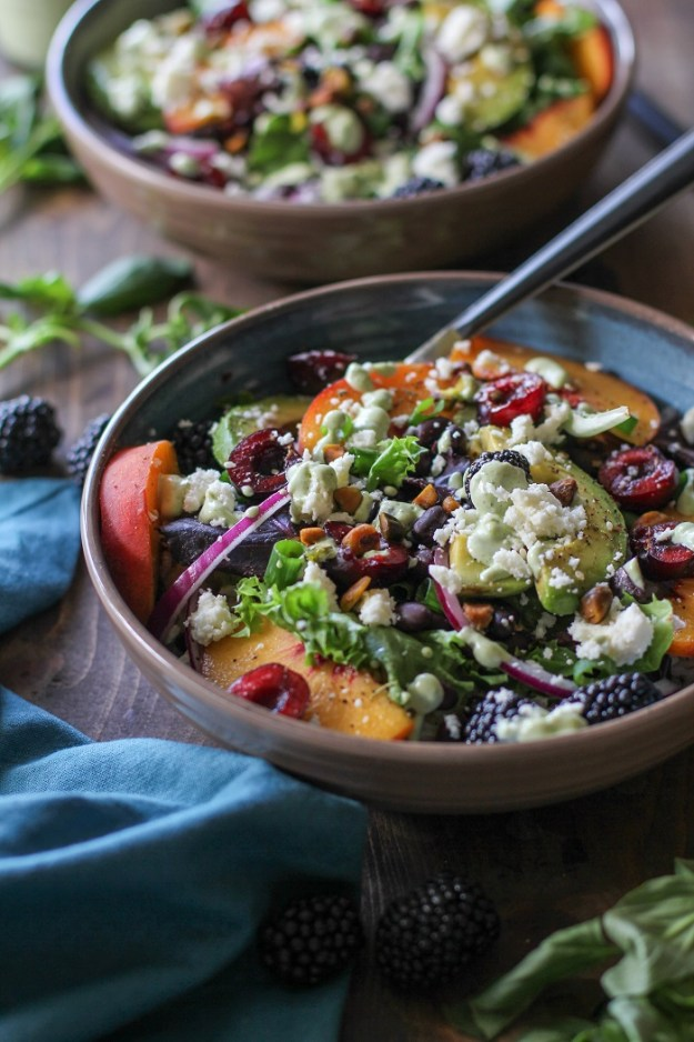 Summer Buddha Bowls with brown rice, mixed greens, summer fruit, black beans, queso fresco, and green goddess dressing | TheRoastedRoot.net #healthy #dinner #recipe #vegetarian