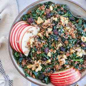 Hormone-Supporting Kale and Quinoa Salad with pumpkin seeds, apple, dried cranberries, and walnuts. This nutrient-dense salad is perfect for eating throughout the week.