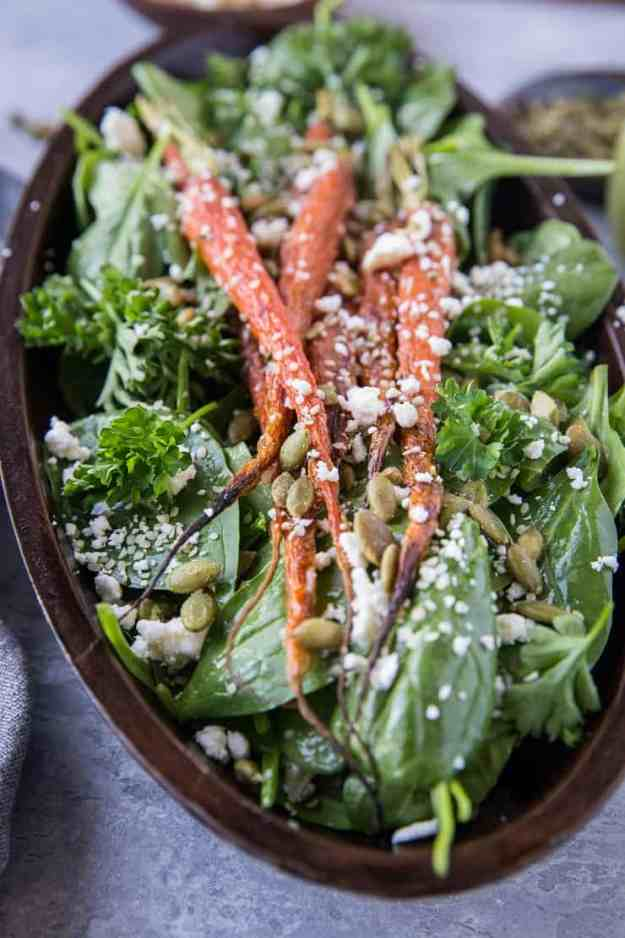 Roasted Carrot Spinach Salad with Lemon Herb Dressing - a simple clean salad that is primal and keto. | TheRoastedRoot.net #cleaneating #vegetarian #glutenfree