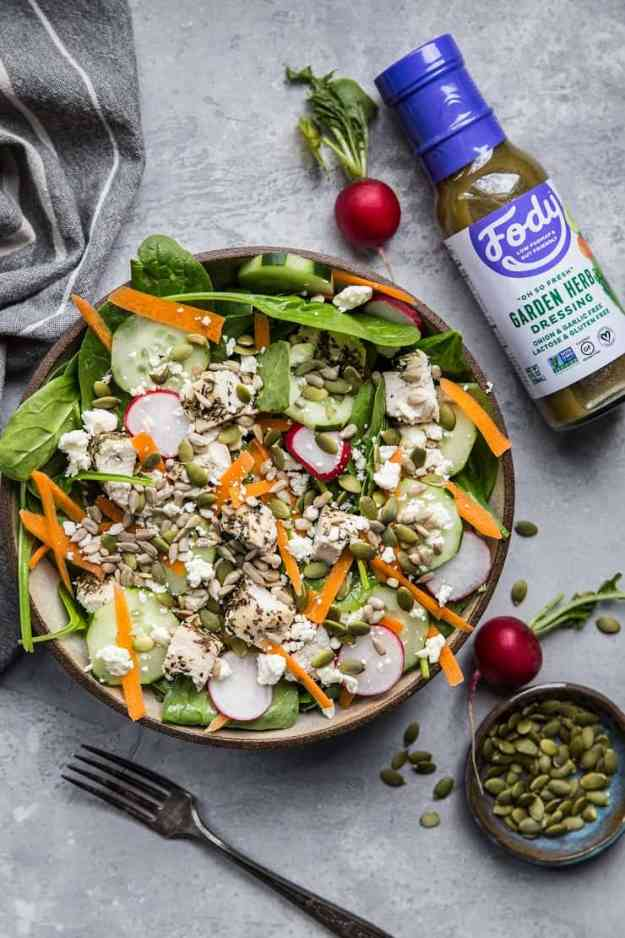 Lemon Herb Baked Chicken Spinach Salad with pumpkin seeds, radishes, cucumbers, feta, and carrots - an easy healthy Low-FODMAP salad recipe | TheRoastedRoot.net