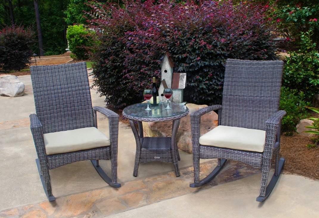 Allweather patio set containing 2 rocking chairs and a