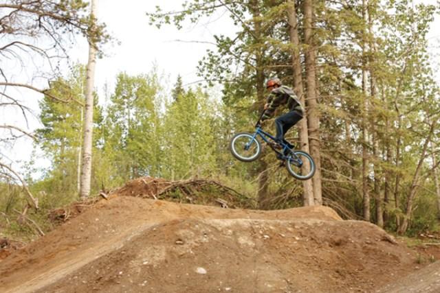 A mountain bike rider seen taking a jump at the Hinton Mountain Bike Park.