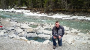 Valemount Mayor Andru McCracken kneels next to the geothermal pools at Lussier Hot Springs, some 25 km south of Fairmont Hot Springs.  Photo submitted