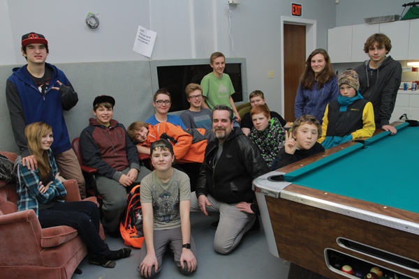 Some of the youth who frequent the V-Crew drop-in youth centre in Valemount, and youth coordinator Daren Sparks (centre)
