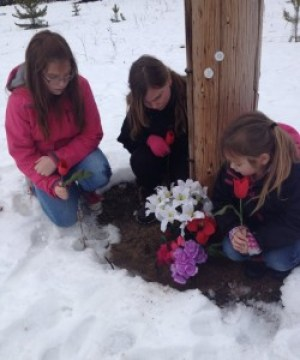 Duska's three daughters lay flowers near where their grandfather, missing since 2007, used to live.