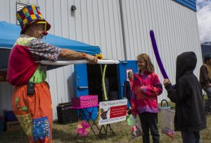 Uncle Chris the Clown entertains local kids at the Sports Grounds last weekend.