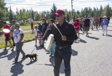Photo: Evan Matthews Chief Nathan Matthew walks with his people toward Tête Jaune Cache.