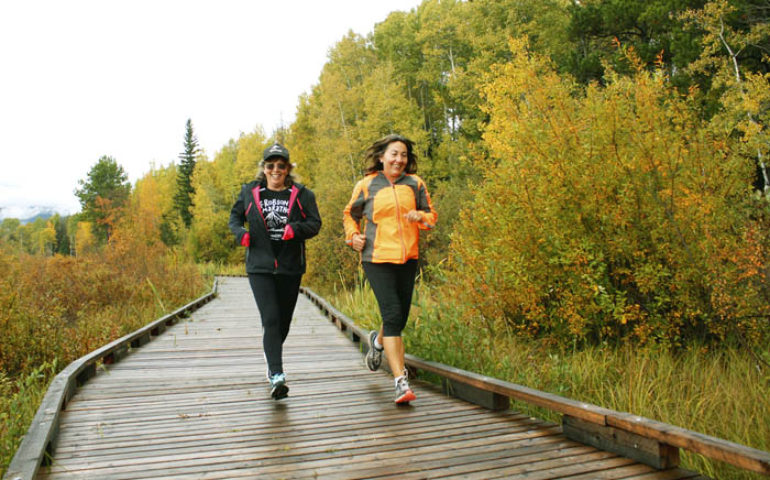 Photo: Evan Matthews These ladies are enjoying the 10 KM through the marsh, as their jackets match the foliage!