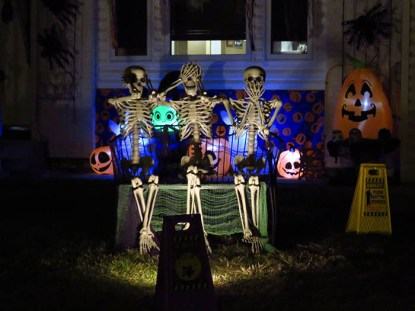 """Kevin and Fran Chiupka's guest skeletons remind passersby to """"Hear no evil, see no evil, and speak no evil""""  / ANDREA ARNOLD"""