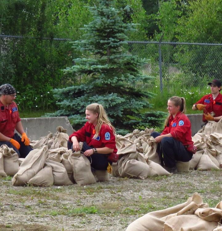 Ready for worse: fire crews fill sandbags in McBride