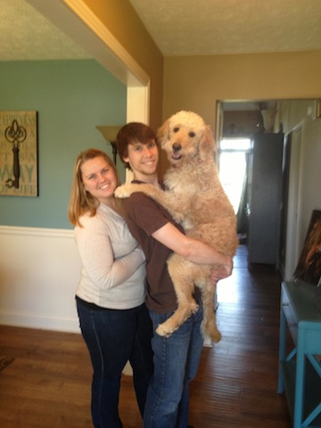 The Rodimel's with Bailey, the Goldendoodle.
