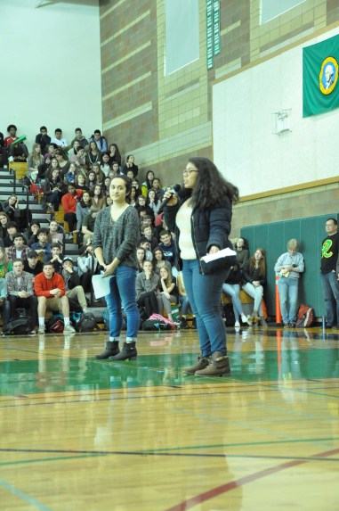Seniors Cassy Aleman and Lusia Moreno speak at the assembly