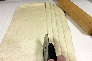 Cut rolled dough into strips.