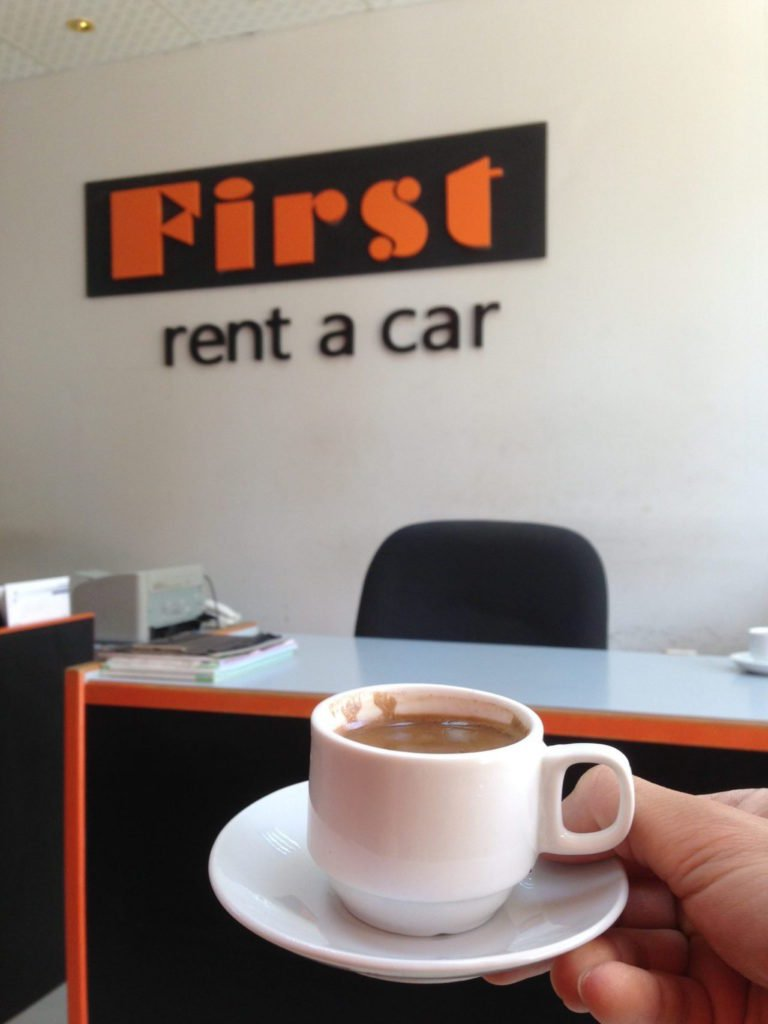 Jordan Car Rental shop with coffee