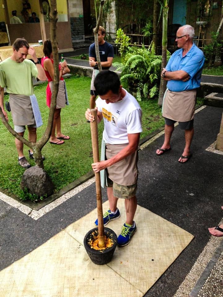 Halef, using a large mortar and pestle, smushing yellow sauce
