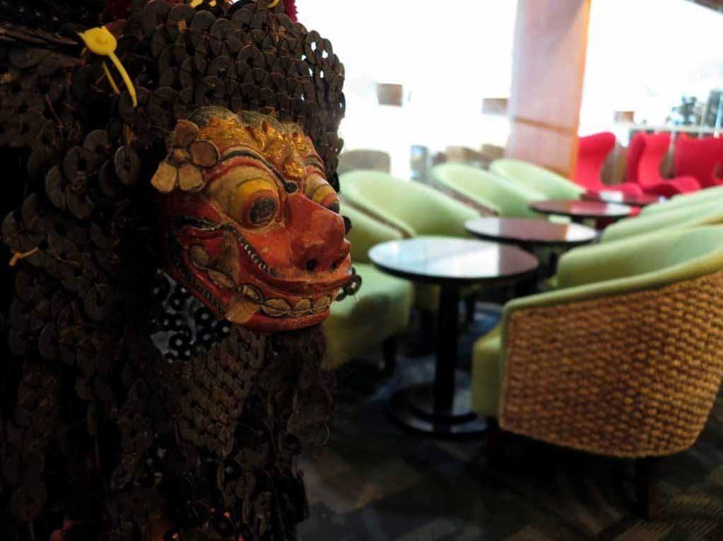Premier Lounge Bali entrance, with a typical Bali mask.