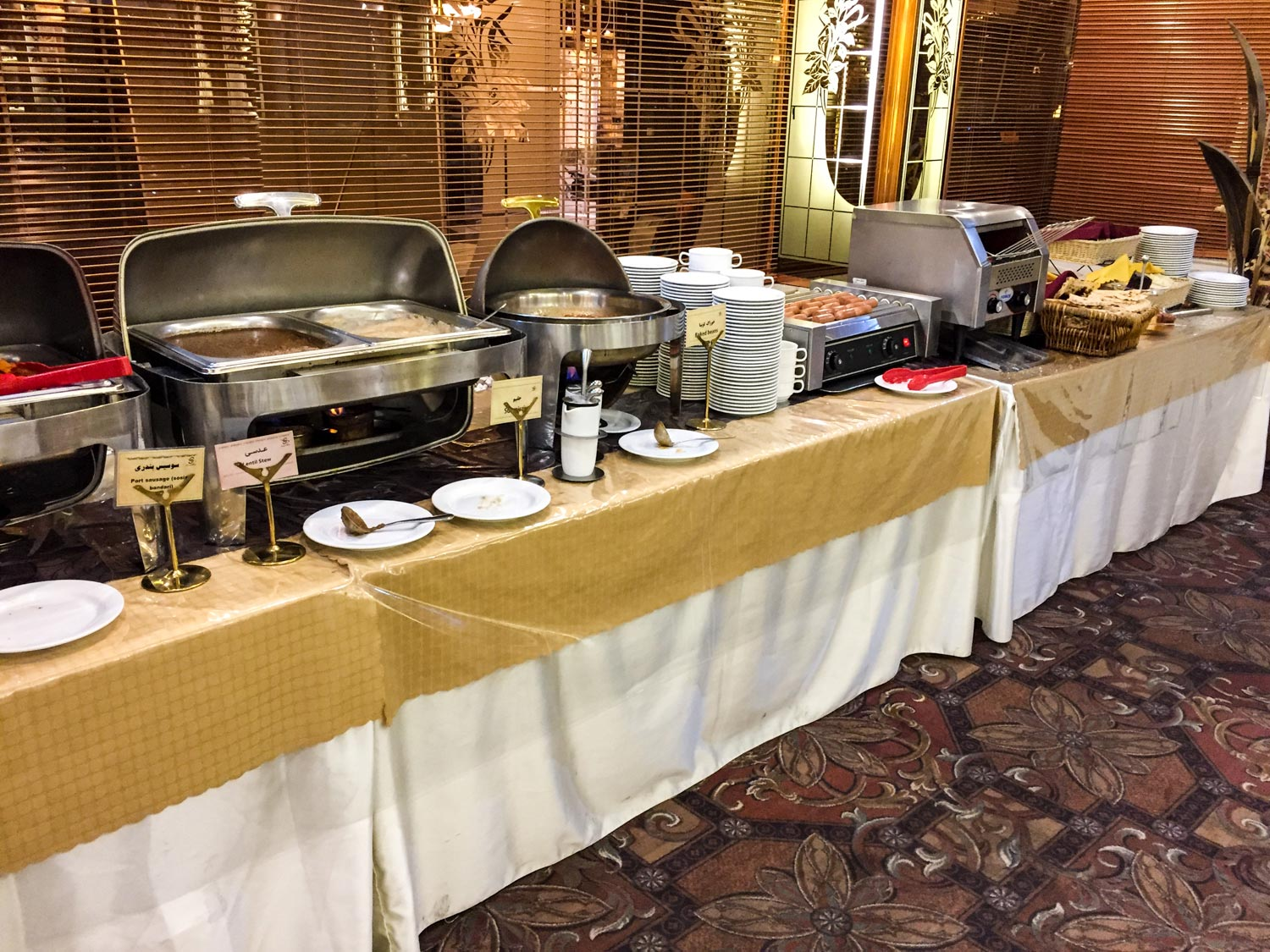 Setareh Hotel Isfahan - buffet items set up with labels detailing the ingredients