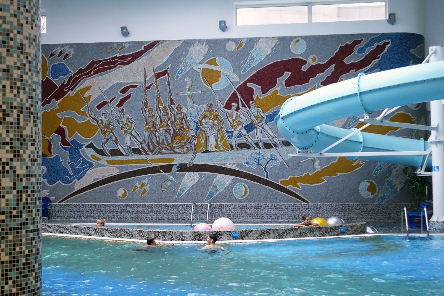 hotel belarus swimming pool with a huge mural on the wall