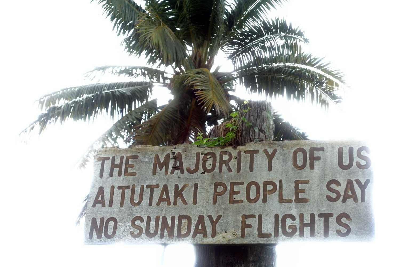Aitutaki culture no sunday flight sign