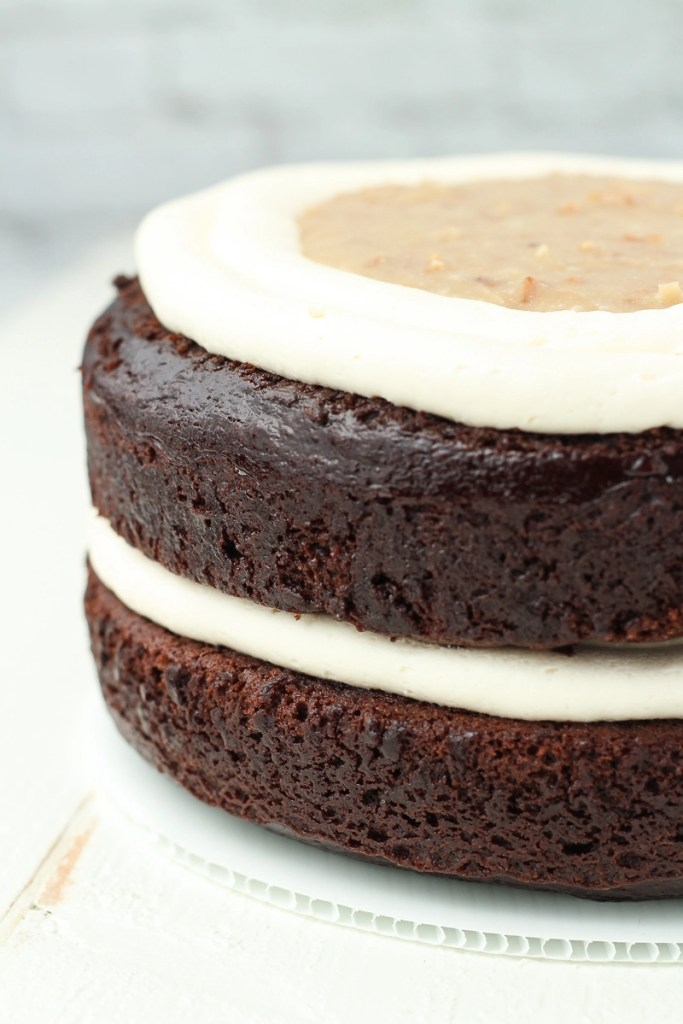 Vegan chocolate cake with vegan caramel and buttercream in between the layers.