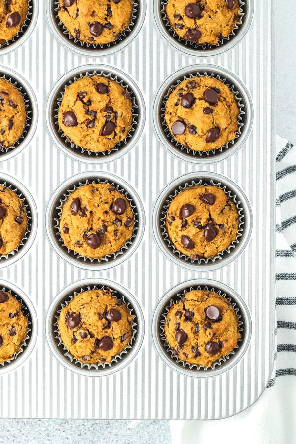 Gluten free pumpkin muffins in a muffin tin.