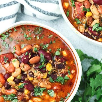 Vegetarian pressure cooker taco soup in a bowl with cilantro on top