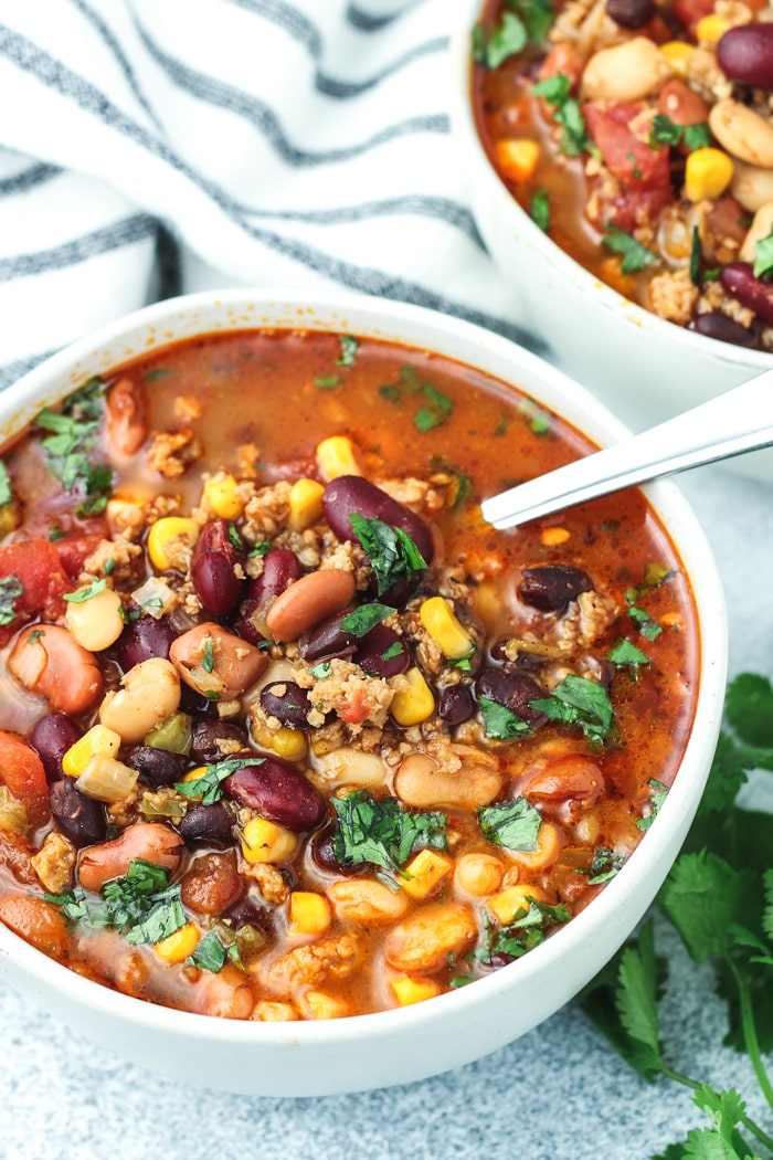 Vegetarian Pressure Cooker Taco Soup in a bowl with a spoon.