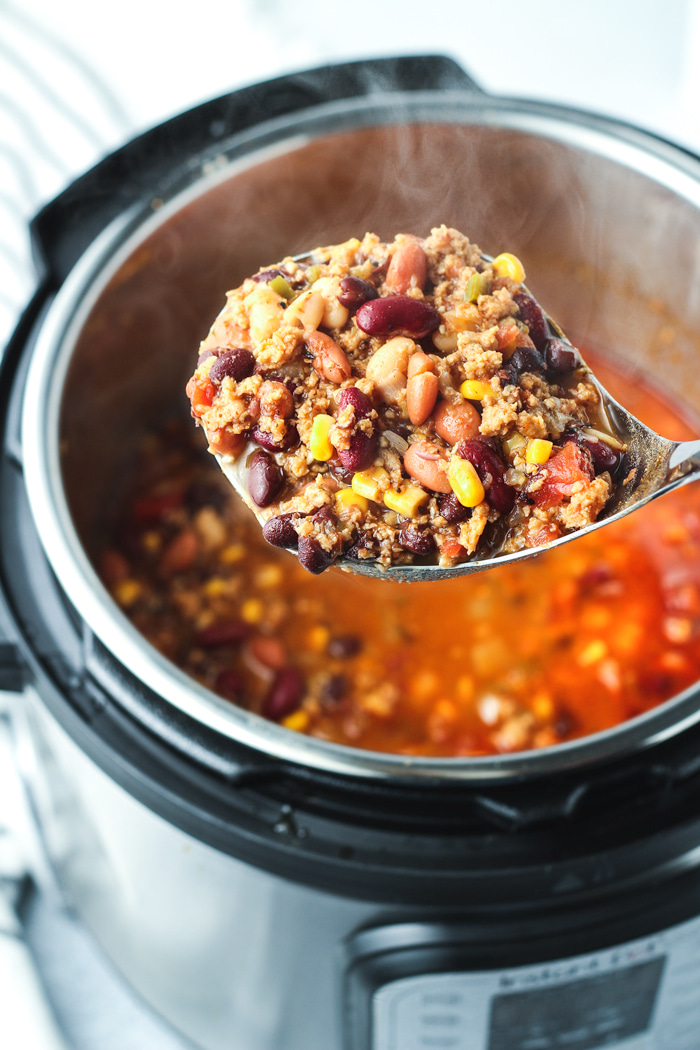 Vegetarian taco soup being ladled out of an instant pot.