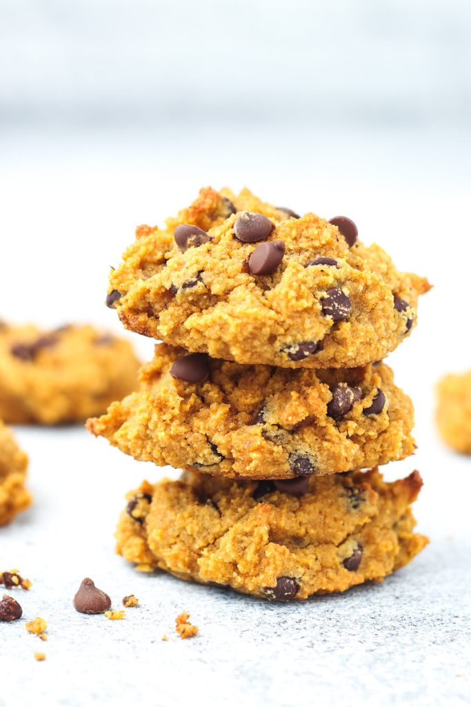 three paleo pumpkin cookies with chocolate chips stacked