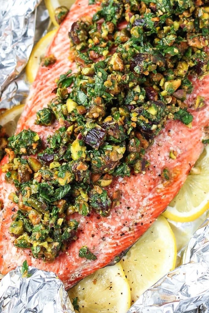 baked salmon topped with pistachio, herbs and dates.