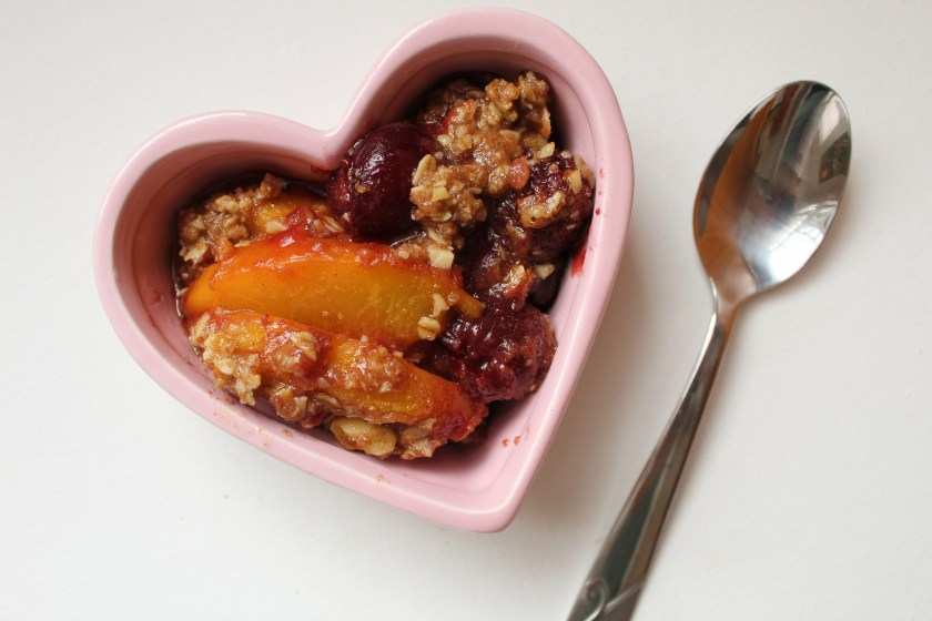 This simple peach & cherry crisp uses frozen fruit and pantry staples for an easy dessert that you can throw together quickly.