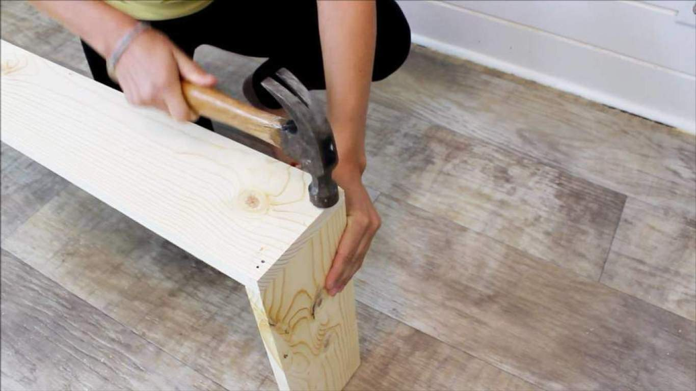 How to build your own rustic diy console table for 30 attach the boards using the finish nails start by nailing the two ends first geotapseo Choice Image