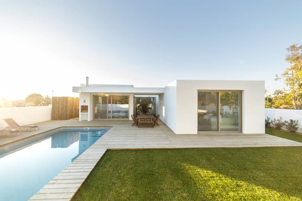 white wood deck inset pool
