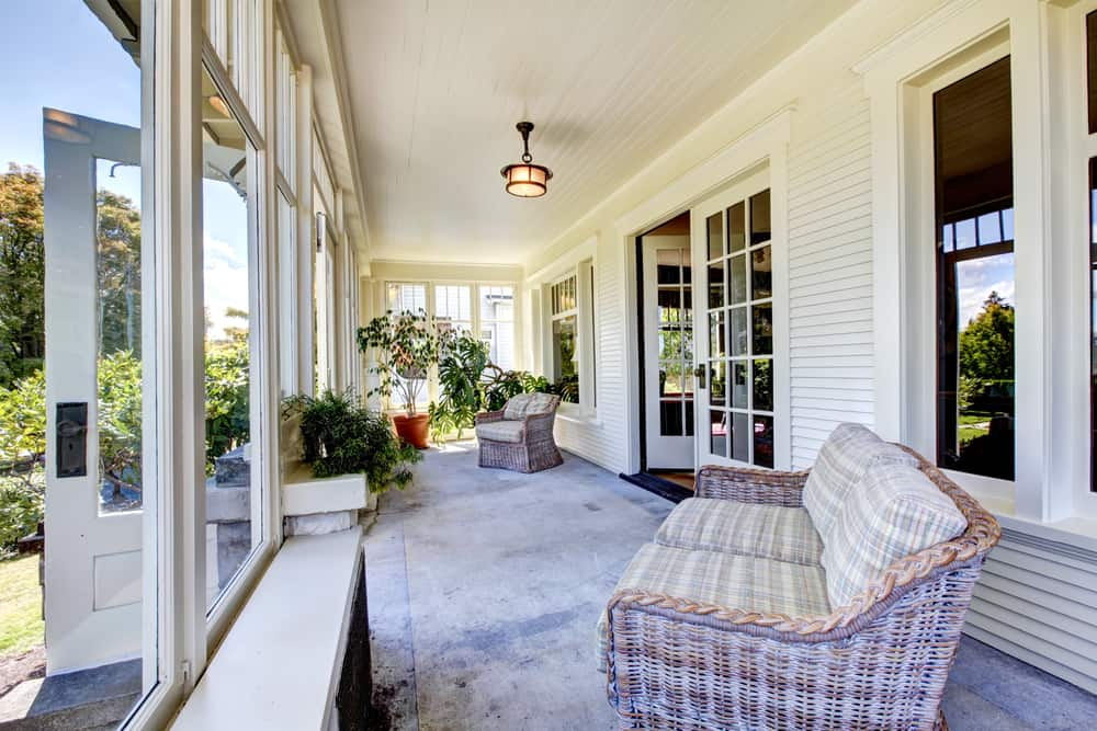 enclosed porch couch plants white