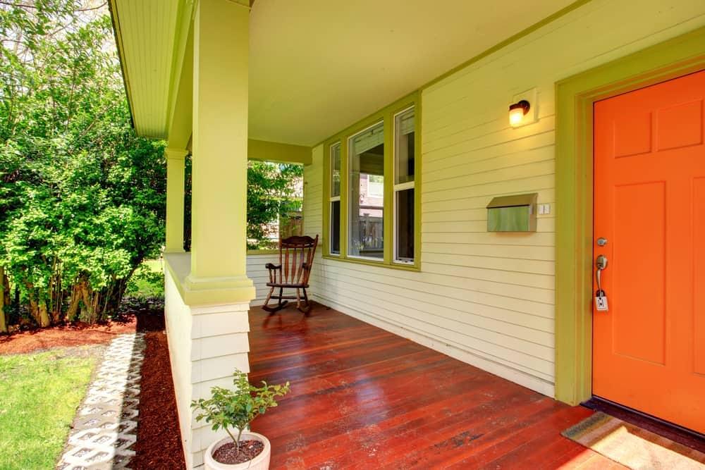 wood flooring yellow siding rocking chiar