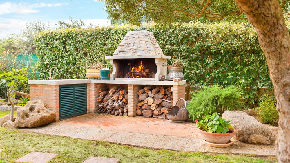 small fireplace with wood storage