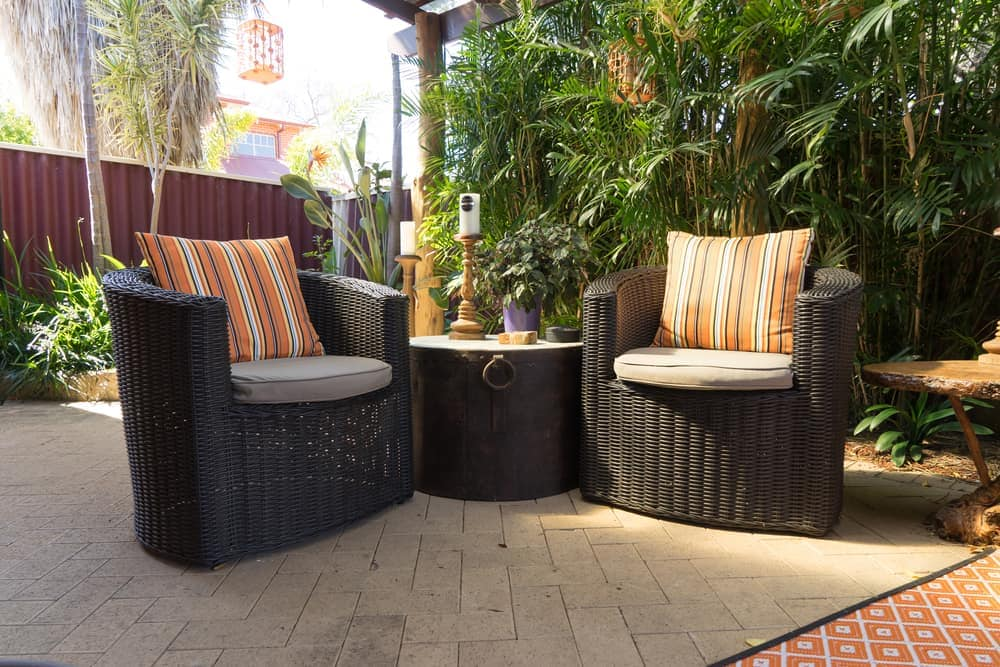 black wicker and pillows