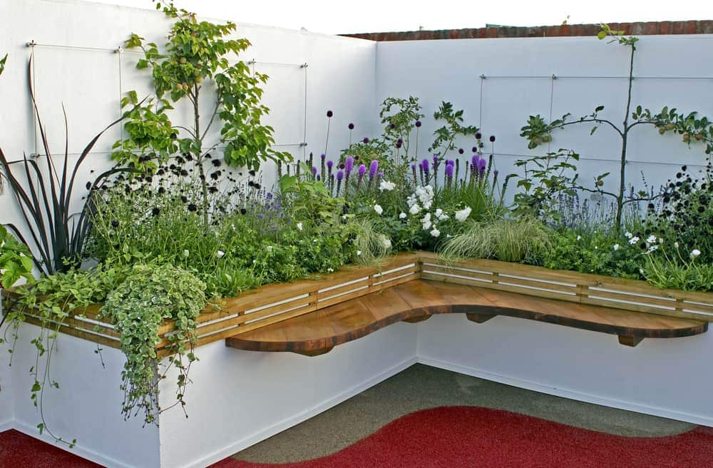 wrapped corner garden with bench