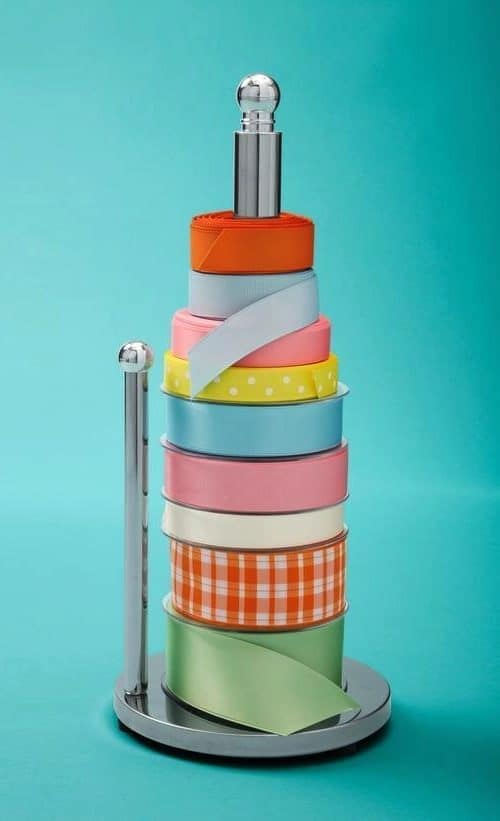 Ribbon Holder There are many uses for a paper towel holder such as this cool ribbon organizer. Your craft room will look fantastic and it is one step closer to having everything organized. thesawguy.com