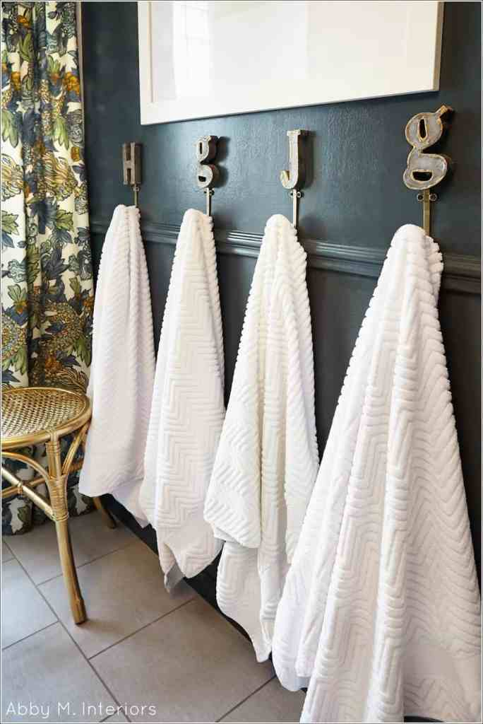Initial Towel Hooks Add some pizzazz to your bathroom decorating while increasing your storage with these towel hooks. Put up an initial for each person in the home and everyone can easily keep track of which towel belongs to which person. How great is that? thesawguy.com