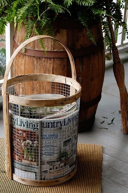 Rustic Magazine Basket Make a magazine basket with an old peach basket, cork mat, twine, glue gun, screws, chicken wire, wire cutters, paint sticks, and scissors. One thing is for sure, you are going to love the result! thesawguy.com