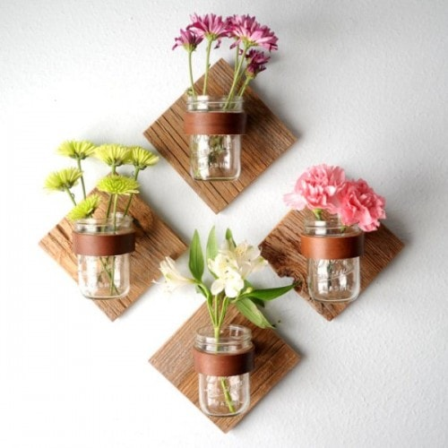 DIY Rustic Mason Jar Sconce Adding rustic sconces to your home will add the right amount of character and charm! Seriously, all you need is some leftover pieces of wood, a mason jar, and some leather strips! It can't get any easier than that!thesawguy.com