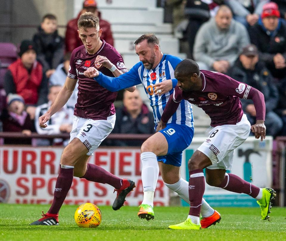 Kris Boyd is framed between Jimmy Dunne and Clevid Dikamona