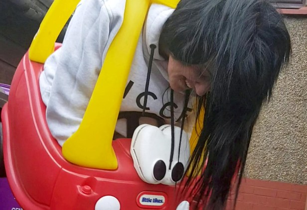 Image result for Scottish woman gets stuck in a children's toy car