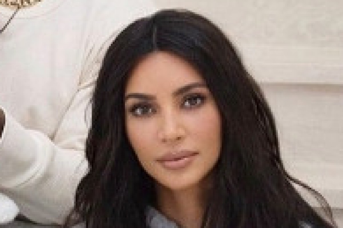 Kim Kardashian and Kanye's son Saint steals the show with a cheeky smile in unfestive family Christmas card